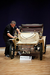 © Licensed to London News Pictures. 01/11/2012. London, UK. Owned from one family since new, the worlds oldest known surviving Vauxhall motor car, a 1903 Vauxhall 5hp Two-seater Light Car (est. GB£60,000-80,000), is polished by a Bonham's Employee at Bonham's New Oxford Street auction house ahead of a veteran car sale this Friday (02/11/12).  The annual auction entitled 'Veteran Motor Cars and Related Automobilia', takes place the on Friday the 2 November, the day before the Bonham's sponsored 'London to Brighton Veteran Car Run' an event for which some of the cars are already registered to enter. Photo credit: Matt Cetti-Roberts/LNP