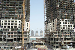 New apartment towers under construction at new Pearl Doha land reclamation property development area in Doha Qatar