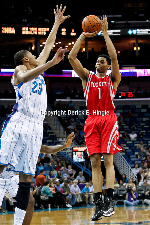 October 24, 2012; New Orleans, LA, USA; Houston Rockets shooting guard Jeremy Lamb (1) shoots over New Orleans Hornets power forward Anthony Davis (23) during the second quarter of a preseason game at the New Orleans Arena.   Mandatory Credit: Derick E. Hingle-US PRESSWIRE
