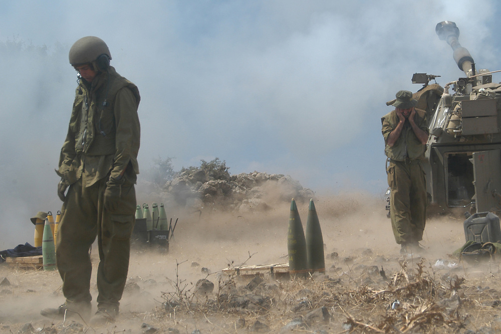 IDF artillery soldiers fire from the Golan Heights towards Hizbullah targets in southern Lebanon. Israel,  August 2006.