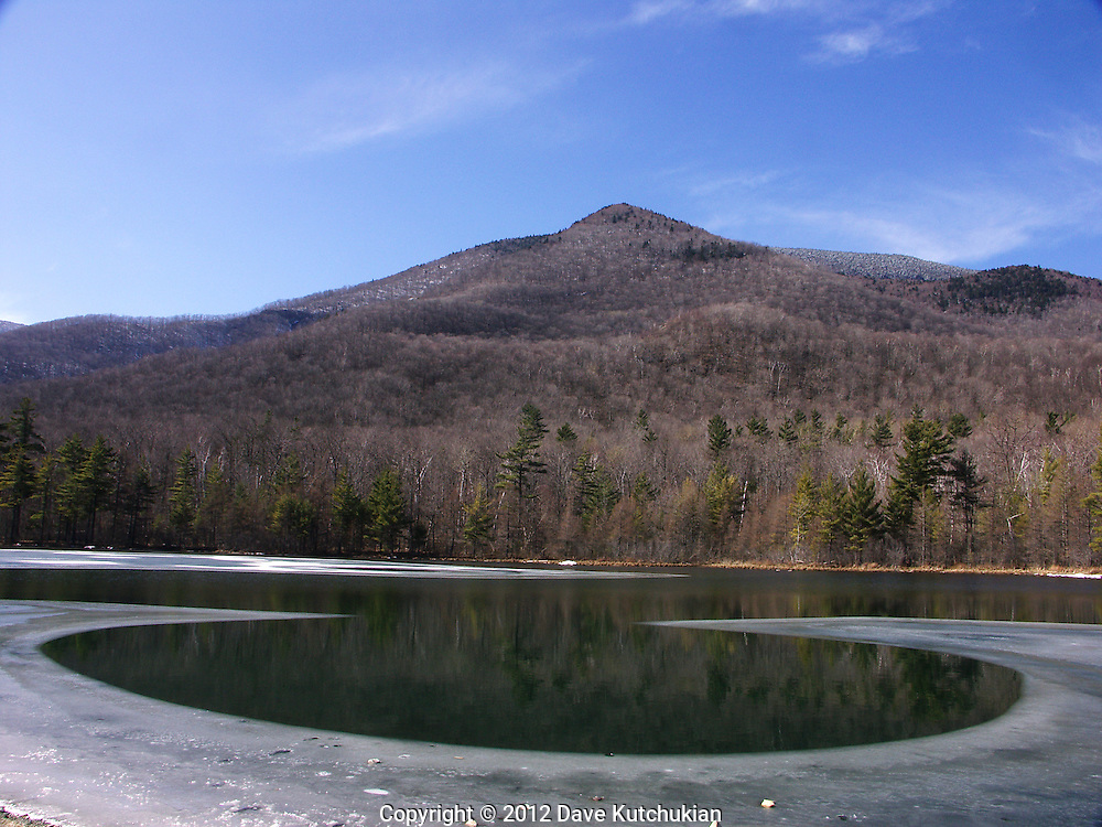 Ice melting out of equinox pond,manchester,vt,early spring