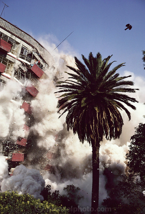 Explosive demolition of the Multi Familiar Juarez, a housing project in Mexico City that was damaged by an earthquake. Demolition by the USA company called Controlled Demolition, Inc, run by three generations of the Loizeaux family. Mexico City, Mexico.