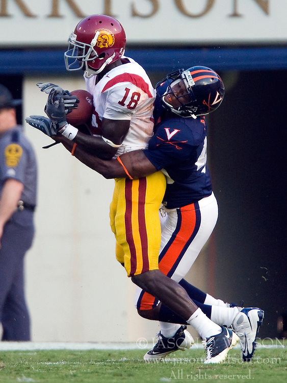 USC wide receiver Damian Williams (18) makes a reception past Virginia cornerback Vic Hall (4).  The #3 ranked University of Southern California Trojans football team defeated the University of Virginia Cavaliers 52-7 at Scott Stadium in Charlottesville, VA on August 30, 2008.