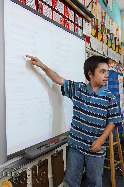 School boy pointing on projection screen