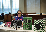 Abigail Gore a member of Sigma Lambda Gamma National Sorority  helps host the canvas painting event on the third floor of Baker Center. Feb. 3rd, 2018.