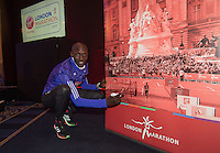 Virgin Money London Marathon 2015<br /> <br /> At the press conference featuring the the leading contenders for the London Marathon  Wilson Kipsang  Kenya signed a picture of  him winning in 2014.<br /> Photo: Bob Martin for Virgin Money London Marathon<br /> <br /> This photograph is supplied free to use by London Marathon/Virgin Money.