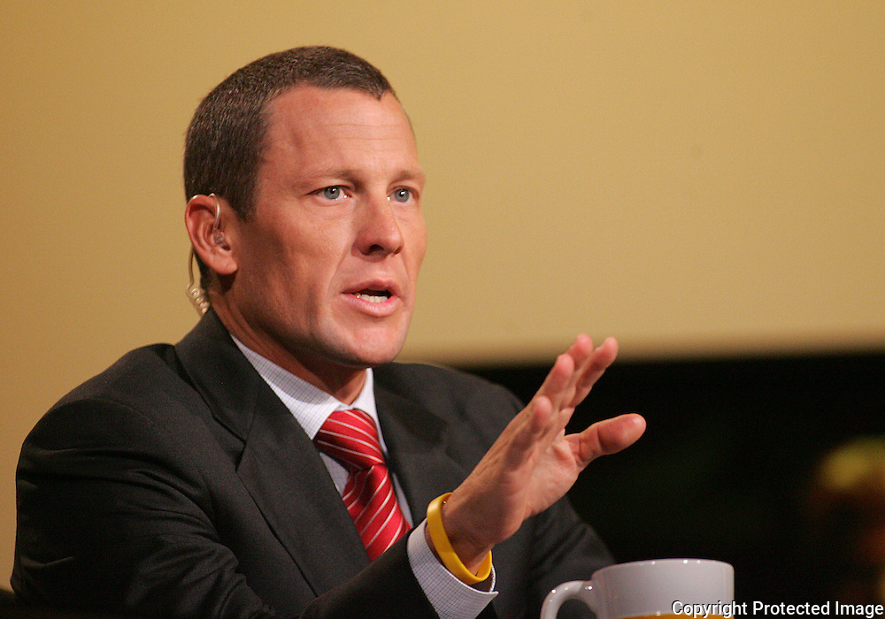 28 August 2007: Seven-time Tour de France winner Lance Armstrong asks a question at the LIVESTRONG Presidential Cancer Forum in Cedar Rapids, Iowa on August 28, 2007.