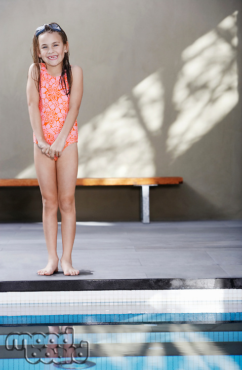 Young Girl Standing By the Pool