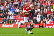 Leeds United midfielder Jamie Shackleton (46) and Barnsley forward Cauley Woodrow (9) during the EFL Sky Bet Championship match between Barnsley and Leeds United at Oakwell, Barnsley, England on 15 September 2019.