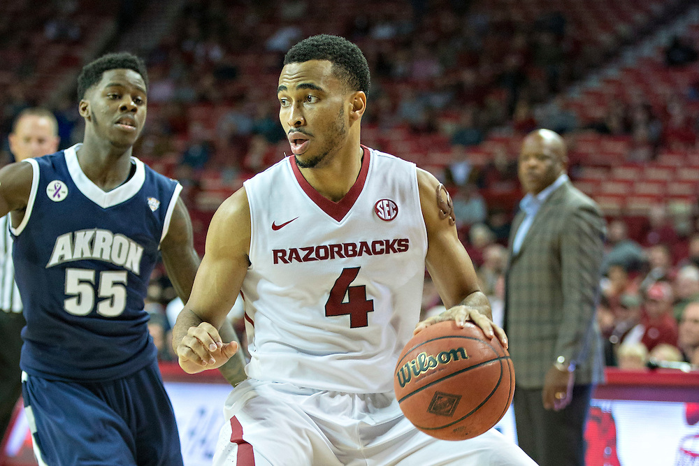 FAYETTEVILLE, AR - NOVEMBER 18:  Jabril Durham #4 of the Arkansas Razorbacks dribbles down the court during a game against the Akron Zips at Bud Walton Arena on November 18, 2015 in Fayetteville, Arkansas.  The Zips defeated the Razorbacks 88-80.  (Photo by Wesley Hitt/Getty Images) *** Local Caption *** Jabril Durham