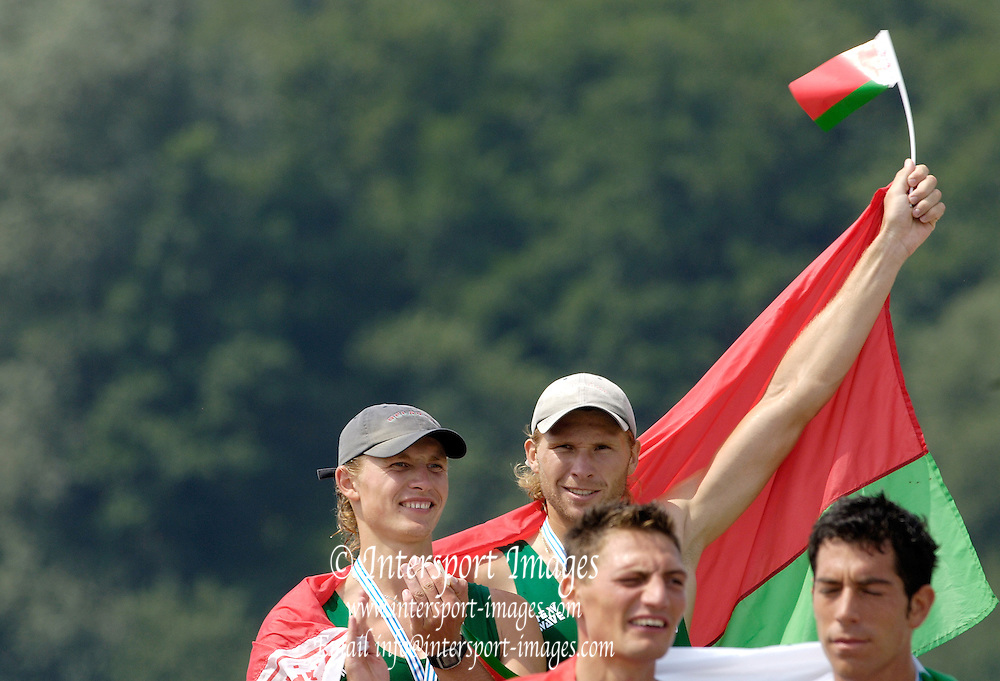 2006, U23 Rowing Championships,Hazewinkel, BELGIUM Sunday, 23.07.2006. BLR, BM2X, Gold medallist, Dzianis MIHAL and Stanislau SHCHARBACHENIA, raise the flag on the awards dock.  Photo  Peter Spurrier/Intersport Images email images@intersport-images.com..[Mandatory Credit Peter Spurrier/ Intersport Images] Rowing Course, Bloso, Hazewinkel. BELGUIM