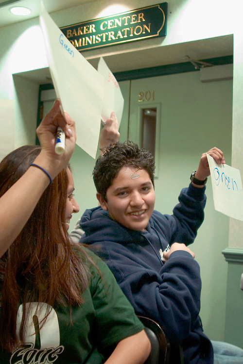 Ohio University junior Paulina Delgadillo looks at brother Luis (age 14) of Cleveland during the how well do you know your sibling game.  This is Luis's third trip to Ohio University for Sib's weekend.