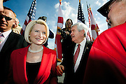 Presidential Hopeful Newt Gingrich and his wife Callista arrive at the stage at a campaign stop outside the River Church in north Tampa.