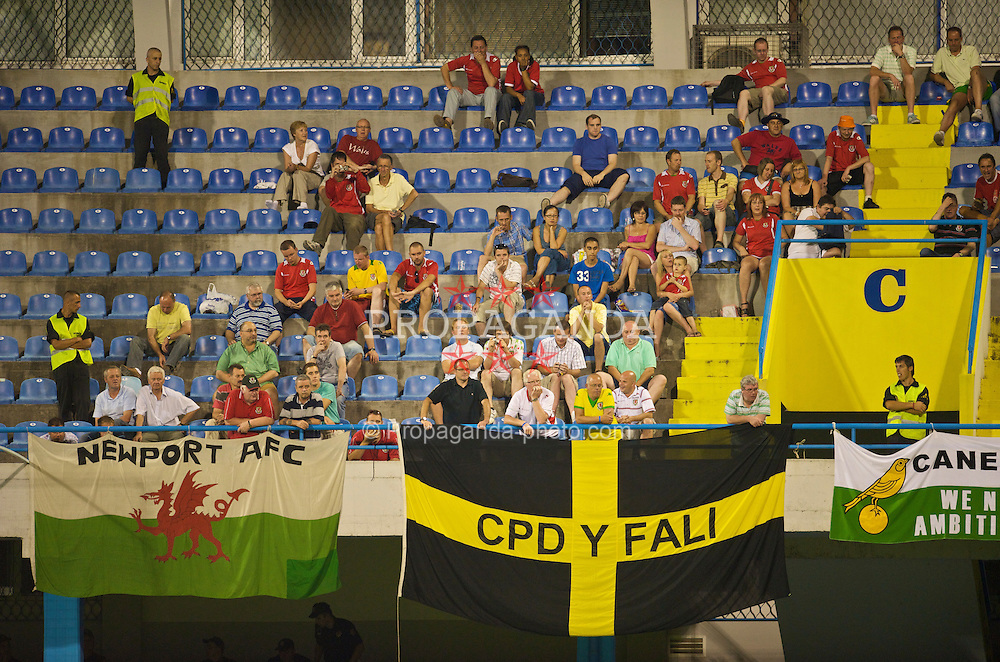 PODGORICA, MONTENEGRO - Wednesday, August 12, 2009: Wales' supporters watche their side take on Montenegro during an international friendly match at the Gradski Stadion. (Photo by David Rawcliffe/Propaganda)