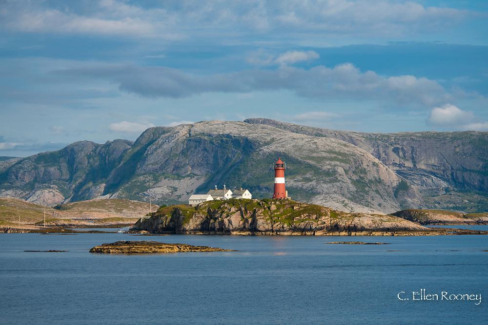 The distinctive Bulholmrasa lighthouse near Trondheim viewed during a Hurtigruten cruise along the northwest coast of Norway.