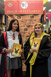 "© Licensed to London News Pictures. 31/07/2016. London, UK.  Shop staff dressed in costume greet fans of the Harry Potter books series visiting Waterstones bookshop in Harrow to buy the ""Harry Potter and the Cursed Child"", the script, in book form, of the play by JK Rowling. Photo credit : Stephen Chung/LNP"