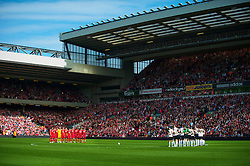 LIVERPOOL, ENGLAND - Sunday, April 11, 2010: Liverpool and Fulham players observe a minutes silence to mark the 21st anniversary of the Hillsborough Stadium Disaster of the 15th April 1989, in which 96 Liverpool supporters lost their lives, before the Premiership match against Fulham at Anfield, the nearest game to the anniversary. (Photo by: David Rawcliffe/Propaganda)