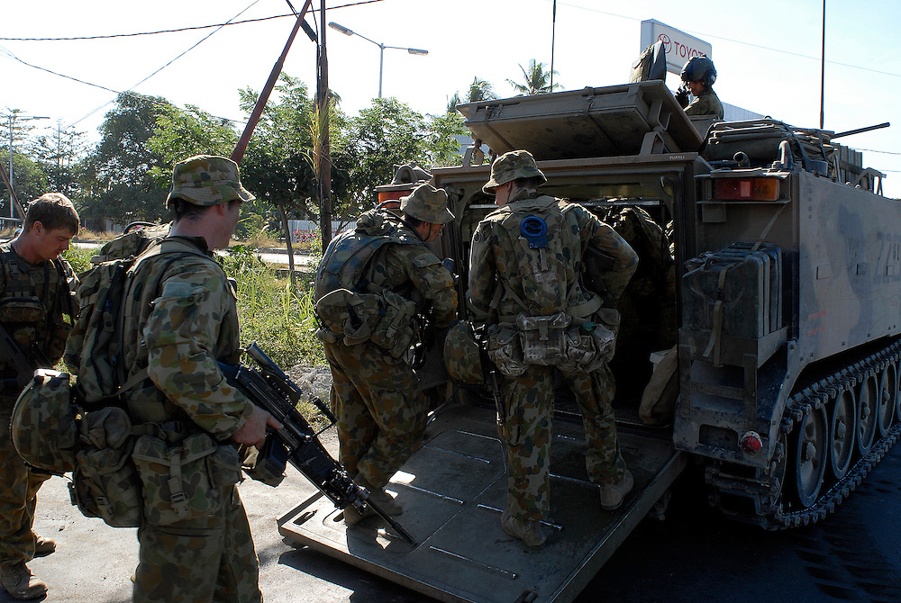 Australian Peacekeepers maintain a heavy presence as they secure the streets of Dili. 070606