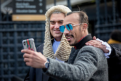 © Licensed to London News Pictures. 11/03/2019. London, UK. A newly-appointed QC poses for a selfie with a member of the public outside the Palace of Westminster after the Silks Ceremony, in which new QCs are formally appointed. Photo credit: Rob Pinney/LNP