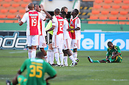 CAPE TOWN, SOUTH AFRICA - 28 MARCH 2010, Ajax Cape Town Players celebrate after beating Golden Arrows 2-1 to reach the semi Finals of the Telkon Knock Out while dejected Golden Arrows players look on during the Telkom Knock Out match between Ajax Cape Town and Golden Arrows held at Newlands Stadium in Cape Town, South Africa..Photo by: Shaun Roy/Sportzpics