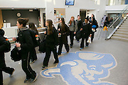 03/19/2014- Medford, Mass. - The women's basketball team leaves the Steve Tisch Sports and Fitness Center for the NCAA Division III Women's Final Four on Mar. 19, 2014. (Kelvin Ma/Tufts University)
