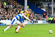 Jack Clarke (47) of Leeds United battles for possession with Luke Freeman (7) of Queens Park Rangers during the The FA Cup 3rd round match between Queens Park Rangers and Leeds United at the Loftus Road Stadium, London, England on 6 January 2019.