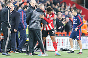 Sheffield United forward Lys Mousset (22) celebrates with Sheffield United Manager Chris Wilder after scoring his team's first goal during the Premier League match between Sheffield United and Arsenal at Bramall Lane, Sheffield, England on 21 October 2019.