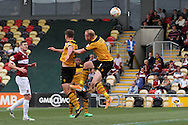 Lee Minshull of Newport (c)scores his side's third goal with a header. Skybet football league two match, Newport county v Northampton Town at Rodney Parade in Newport, South Wales on Saturday13th Sept 2014<br /> pic by Mark Hawkins, Andrew Orchard sports photography.