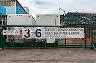 "2016/05/26 - Caracas, Venezuela: Polar beer factory gate in Caracas with a sign ""36 days wanting to produce but without raw material, we can't!!!"" Polar is the biggest food conglomerate in Venezuela. (Eduardo Leal)"