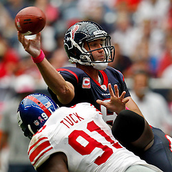 October 10, 2010; Houston, TX USA; Houston Texans quarterback Matt Schaub (8) is pressured by New York Giants defensive end Justin Tuck (91) during the first half at Reliant Stadium. Mandatory Credit: Derick E. Hingle