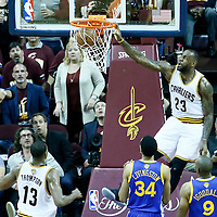 08 June 2016: Cleveland Cavaliers forward LeBron James (23) dunks the ball on a pass by Cleveland Cavaliers guard Kyrie Irving (2) during the Cleveland Cavaliers 120-90 victory over the Golden State Warriors, during Game Three of the 2016 NBA Finals at the Quicken Loans Arena, Cleveland, Ohio, USA.