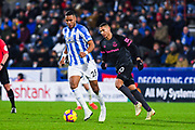 Mathias Zanka Jorgensen of Huddersfield Town (25) in action  with Richarlison of Everton (30) nearby during the Premier League match between Huddersfield Town and Everton at the John Smiths Stadium, Huddersfield, England on 29 January 2019.