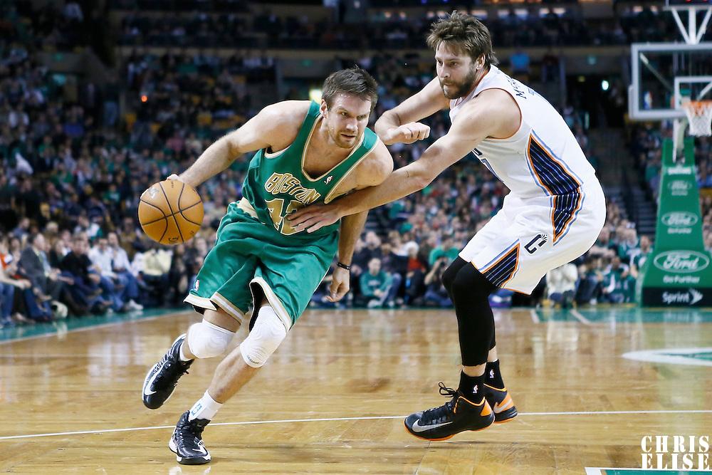 16 March 2013: Boston Celtics power forward Shavlik Randolph (42) drives past Charlotte Bobcats power forward Josh McRoberts (11) during the Boston Celtics 105-88 victory over the Charlotte Bobcats at the TD Garden, Boston, Massachusetts, USA.