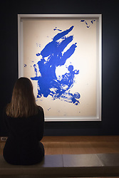 Christies, St James, London, February 5th 2016. A woman views  Yves Klein's  Anthropométries Sans Titre (ANT 118), which is expected to fetch between £8-14 million at acuction, during the 20th Century Art Sale Preview. ///FOR LICENCING CONTACT: paul@pauldaveycreative.co.uk TEL:+44 (0) 7966 016 296 or +44 (0) 20 8969 6875. ©2015 Paul R Davey. All rights reserved.