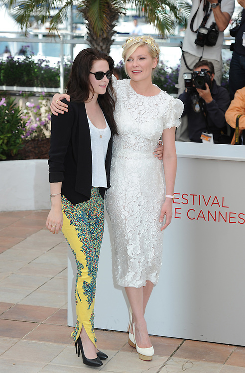 .Actresses Kristen Stewart (L) and Kirsten Dunst during the 65th Annual Cannes Film Festival at Palais des Festivals on May 23, 2012 in Cannes, France..Photo Ki Price.