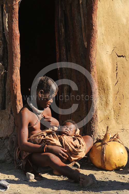 The Himba (singular: OmuHimba, plural: OvaHimba) are indigenous peoples with an estimated population of about 50,000 people living in northern Namibia, in the Kunene region (formerly Kaokoland) and on the other side of the Kunene River in Angola.There are also a few groups left of the Ovatwa, who are also OvaHimba, but are hunters and gatherers. The OvaHimba are a semi-nomadic, pastoral people, culturally distinguishable from the Herero people in northern Namibia and southern Angola, and speak OtjiHimba (a Herero language dialect), which belongs to the language family of the Bantu.The OvaHimba are considered the last (semi-) nomadic people of Namibia.