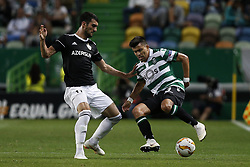 September 20, 2018 - Lisbon, Portugal - Mahir Madatov of Qarabag FK (L) vies for the ball with Marcos Acuna of Sporting (R)  during Europa League 2018/19 match between Sporting CP vs Qarabagh FK, in Lisbon, on September 20, 2018. (Credit Image: © Carlos Palma/NurPhoto/ZUMA Press)