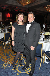 ANALISA ARISS and BRAD ARISS at the 20th CEW (UK) Achiever Awards 2012 - celebrating two decades of women, passion, beauty, held at the Hilton, park Lane, London on 16th October 2012.