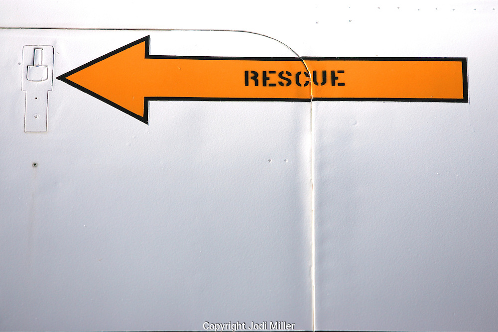 A yellow arrow that says rescue pointing to an escape hatch.