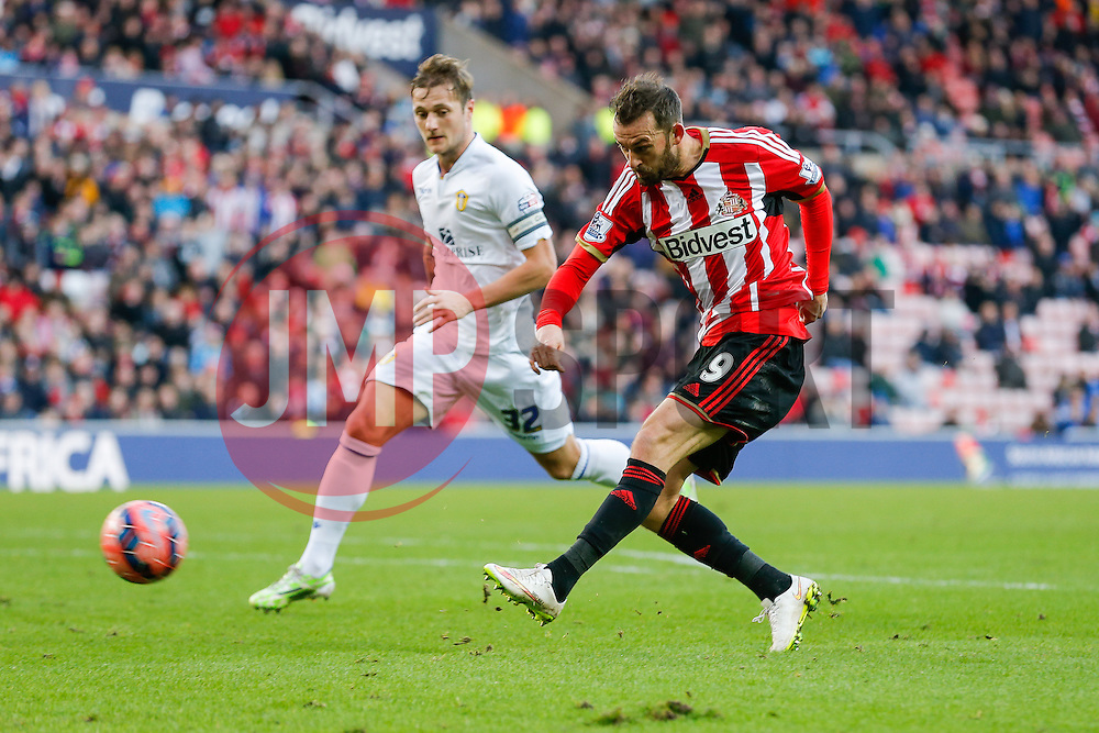 Steven Fletcher of Sunderland shoots as Liam Cooper of Leeds United challenges - Photo mandatory by-line: Rogan Thomson/JMP - 07966 386802 - 04/01/2015 - SPORT - FOOTBALL - Sunderland, England - Stadium of Light - Sunderland v Leeds United - FA Cup Third Round Proper.