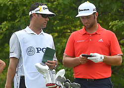 August 12, 2018 - St. Louis, Missouri, U.S. - ST. LOUIS, MO - AUGUST 12: Jon Rahm checks details on how to play the #2 hole with his caddie during the final round of the PGA Championship on August 12, 2018, at Bellerive Country Club, St. Louis, MO.  (Photo by Keith Gillett/Icon Sportswire) (Credit Image: © Keith Gillett/Icon SMI via ZUMA Press)