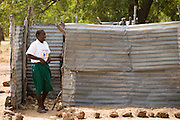 Girl coming out of an outdoor latrine at school.Northern Ghana, Wednesday November 12, 2008.