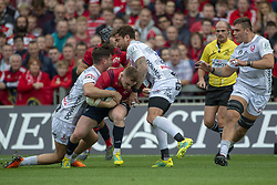 October 20, 2018 - Limerick, Ireland - Rory Scannell of Munster tackled by Danny Cipriani and Mark Atkinson of Gloucester during the Heineken Champions Cup match between Munster Rugby and Gloucester Rugby at Thomond Park in Limerick, Ireland on October 20, 2018  (Credit Image: © Andrew Surma/NurPhoto via ZUMA Press)