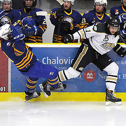 COBOURG, ON - Dec 23 : Ontario Junior Hockey League Game Action between the Cobourg Cougars and the Buffalo Jr. Sabres, Maxwell Mikowski #18 of the Buffalo Junior Sabres Hockey Club  takes the hit from Ryan Logan #11 of the Cobourg Cougars Hockey Club during third period game action.<br /> (Photo by Andy Corneau / OJHL Images)