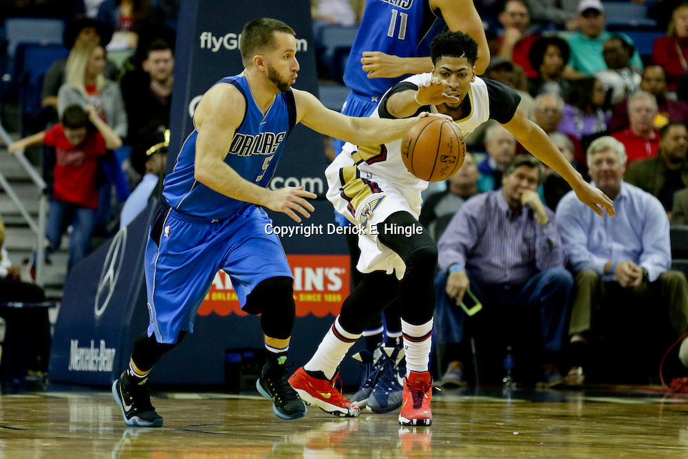 Jan 6, 2016; New Orleans, LA, USA; New Orleans Pelicans forward Anthony Davis (23) reaches for the ball as Dallas Mavericks guard J.J. Barea (5) drives down court during the second quarter of a game at the Smoothie King Center. Mandatory Credit: Derick E. Hingle-USA TODAY Sports