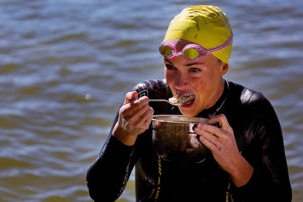 SPOTSYLVANIA, VA - OCTOBER 9, 2016: Shanda Hill takes a break to eat in Lake Anna during the first day of the Quintuple Anvil race in Lake Anna State Park in Spotsylvania, Virginia. CREDIT: Sam Hodgson for The New York Times.