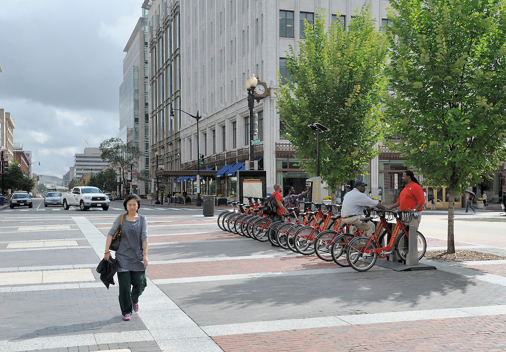 Female walker before bicycle rental station in Washington DC
