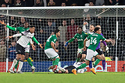 George Evans (17) is flattened during the EFL Sky Bet Championship match between Derby County and Sheffield Wednesday at the Pride Park, Derby, England on 11 December 2019.