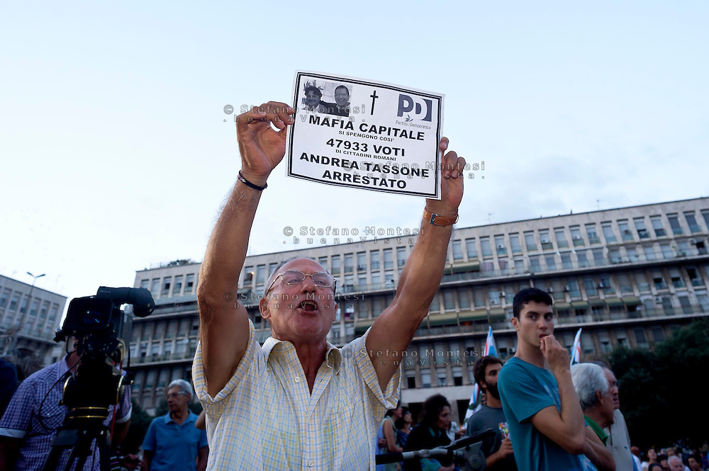 """Rome, Italy  September 03, 2015<br /> Demostration anti-mafia, called by the centre-left Democratic Party,  at the church of Don Bosco in Rome to protest the ostentatious funeral of the purported Italian crime boss, Vittorio Casamonica, and to take a public stand against Italy's powerful crime syndicates. The Caravan of the Suburbs and the union Asia-USB, against the Democratic Party during the demonstration against the mafia, shouting"""" Mafia Capital is within you. """""""