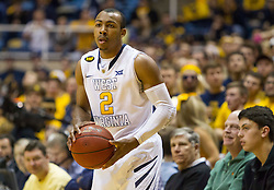 West Virginia Mountaineers guard Jevon Carter (2) passes the ball in bounds against the Kansas Jayhawks during the second half at the WVU Coliseum.